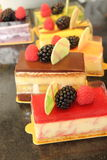 Fruit  decorated pastries  cakes and slices of cakes. Royalty Free Stock Images