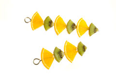 Fruit decoration. Orange and kiwi slices on a skewer Stock Photo