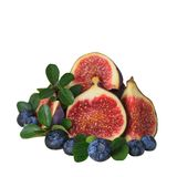 Fruit decoration with fig isolated on white. Fruit topping decoration with fig, blueberry and leaves Royalty Free Stock Photo