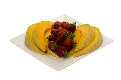 Fruit desert with cantaloupe and strawberries Royalty Free Stock Photo