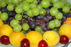 Fruit desert plate. On the table close-up Stock Image