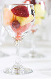 Fruit Dessert. Delicious fruit dessert of strawberries, mango, peach, grapes and cherries royalty free stock photos