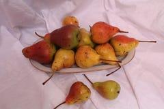 Fruit on dessert. Appetizing ripe sweet yellow pear fruits cut on half for dessert royalty free stock image