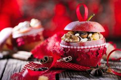 Fruit dessert baked red apples stuffed with granola.  stock photos