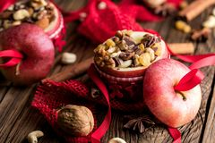 Fruit dessert baked red apples stuffed with granola.  stock photo