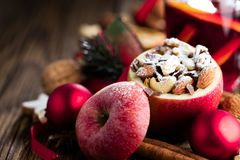 Fruit dessert baked red apples stuffed with granola.  stock image