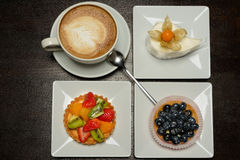 Fruit dessert and capuccino Royalty Free Stock Photo