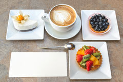Fruit dessert and capuccino Stock Image