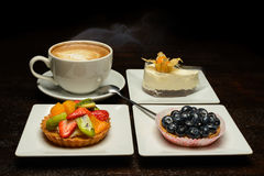 Fruit dessert and capuccino Royalty Free Stock Photos