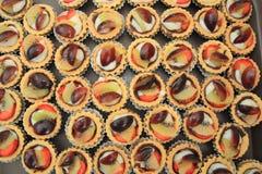 Fruit dessert Chocolate tarts. Royalty Free Stock Photo