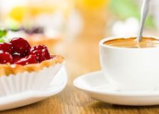 Fruit dessert and coffee Stock Image
