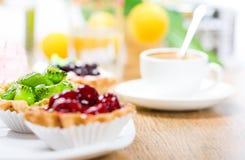 Fruit dessert and coffee Stock Photos