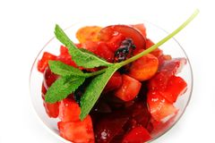 Fruit dessert with green mint Stock Images