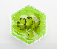 Fruit dessert hexagonal shape with a transparent green jelly and Royalty Free Stock Photography