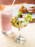 Fruit dessert with ice cream on table Royalty Free Stock Image