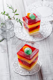 Fruit dessert Panna Cotta with candies in a glass on light background close up. Royalty Free Stock Photography