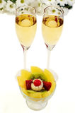 Pineapple, Kiwi, strawberry, and two glasses of champagne Royalty Free Stock Photos