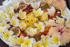 Fruit Dessert Salad With Pineapple, Papaya, Passion Fruit, And White Frangipani Flower Stock Photo