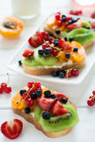 Fruit dessert sandwiches with ricotta cheese, kiwi, apricot, strawberry, blueberry and red currant Stock Photos