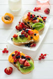 Fruit dessert sandwiches with ricotta cheese, kiwi, apricot, strawberry, blueberry and red currant Stock Images