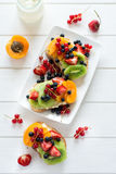 Fruit dessert sandwiches with ricotta cheese, kiwi, apricot, strawberry, blueberry and red currant Stock Photo