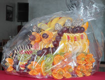 Fruit. Dessert with slices of citrus and berries packed in polyethylene Royalty Free Stock Images