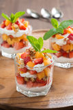 fruit dessert with whipped cream and granola, vertical Royalty Free Stock Images