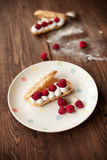 Fruit dessert on white plate on wood table. Fruit dessert on white plate on rustic wood table Royalty Free Stock Image