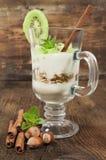 Fruit dessert with yogurt and kiwi Royalty Free Stock Photography