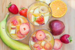 Fruit desserts with fresh fruits. Fruit jellt desserts in glasses with fresh fruits on a wooden table , top view stock photo