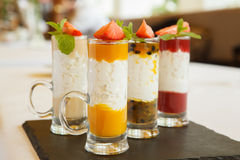 Fruit desserts. Variety of fruit puree with whipped cream Royalty Free Stock Images