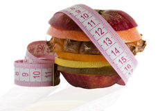 Fruit diet. Slice of fruits and Measuring Tape isolated royalty free stock photo