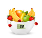 Fruit with in a digital weight scale. Diet concept. Stock Photo