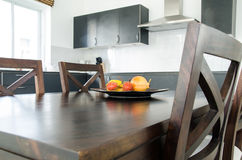 Fruit on Dining table in kitchen room. Dining table in kitchen room ath home Stock Photography