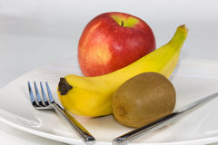 Fruit dinner. On a plate with cutlery Royalty Free Stock Photo