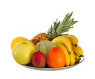 Fruit dish. Various freshly tropical fruit on saucer on white background Stock Photos