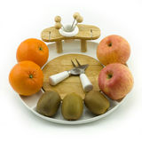 Fruit on plate. Apples, oranges and kiwies on a white china fruit plate Royalty Free Stock Photos