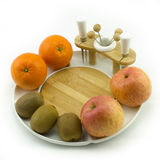 Fruit on plate. Apples, oranges and kiwies on a white china fruit plate Royalty Free Stock Photography