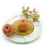 Fruit on plate. Apples on a white china fruit plate Royalty Free Stock Images