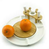 Fruit on plate. Oranges on a white china fruit plate Stock Image