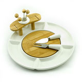 Fruit plate. A white fruit china plate with knife and fork Royalty Free Stock Images