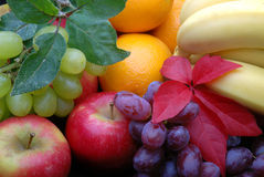Fruit display. Selection of various fruit, apples,oranges,grapes and bannanas stock images
