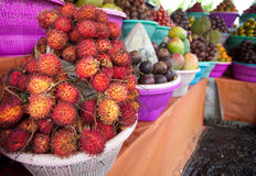 Fruit display in market. Fruit display on small streetside stall in Bali Stock Images