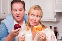 Fruit or Donut Healthy Eating Decision Stock Images