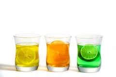 Fruit and Drink. Refreshing Tri-color fruit drinks, Lemon, Lime, and Orange Stock Images