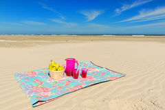 Fruit and drink at the beach Stock Images
