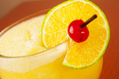 Fruit drink. A close up of a fruits drink with lime and cherry decoration Stock Images