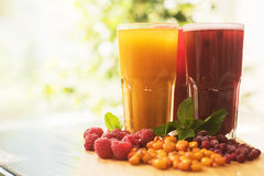 Fruit drink with cranberries raspberries and sea buckthorn Stock Photography