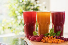 Fruit drink with cranberries raspberries and sea buckthorn Stock Photos