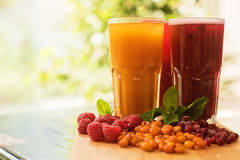Fruit drink with cranberries raspberries and sea buckthorn Royalty Free Stock Images